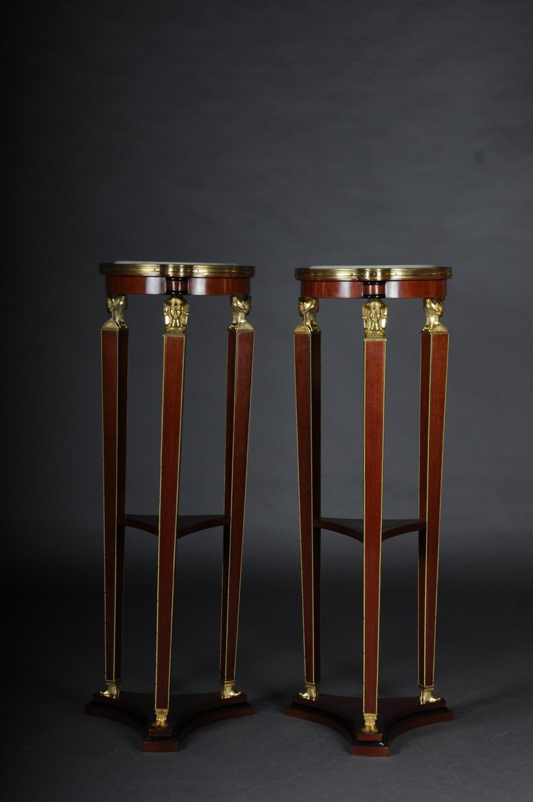 Rosewood veneer on solid wood. Round body with marble slab on Karyadites with tapering square legs in sabots ending on three sided recessed base plate. The fittings are pronounced and of exceptionally good quality. Beautiful patina, with shellac