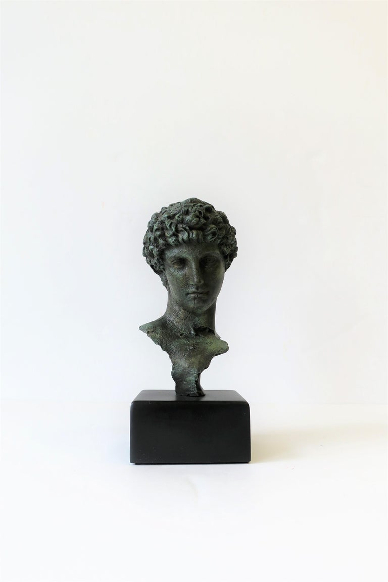 A classical male bust sculpture piece on a black base. Excellent condition.   Piece measures: 3.25 in. W x 3 in. D x 8 in. H.