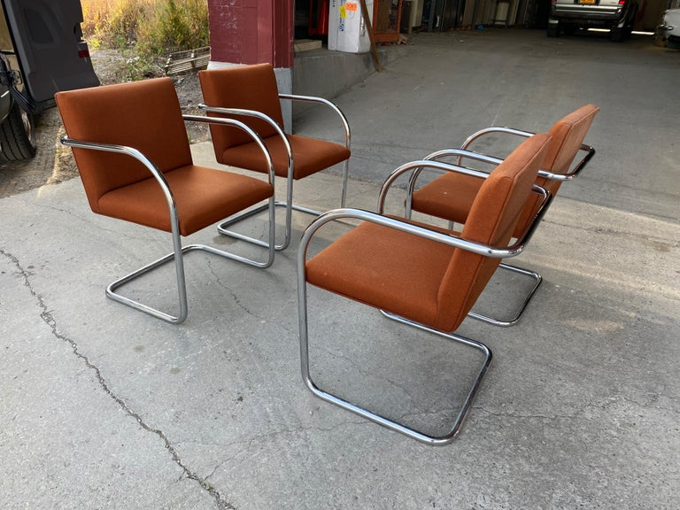 Classic set of 4 midcentury Brno chairs by Mies van der Rohe for Gordon International, beautiful polished chrome tubular steel, retain original orange wool fabric, minor blemishes and sun fading to backs.