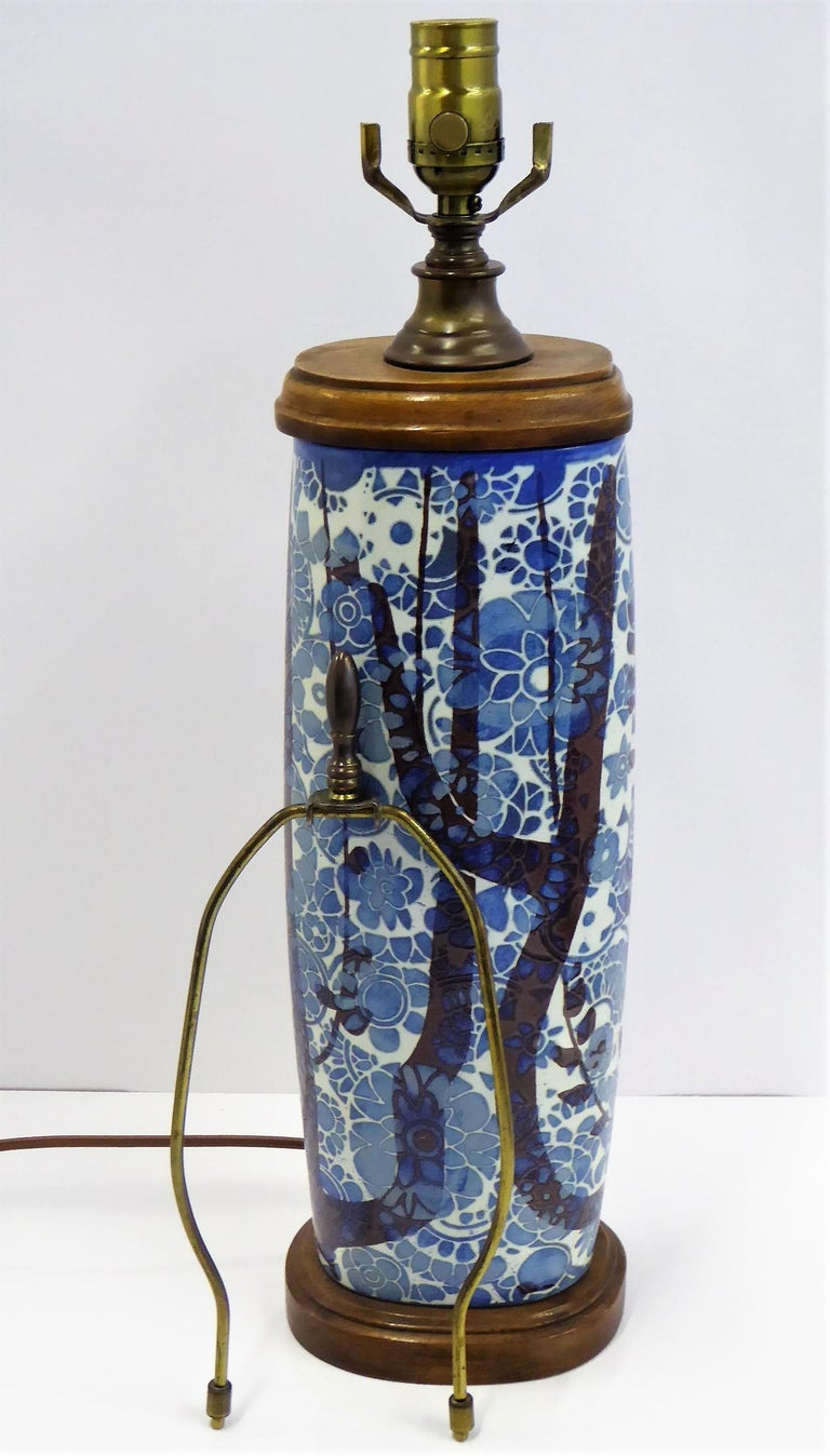 An elegant and Classic Danish vase exquisitely mounted as a table lamp. Nils Thorsson created the Baca series of pottery for Aluminia/Royal Copenhagen and on this particular form of vase from 1965, the artist Johanne Gerber designed the wood and