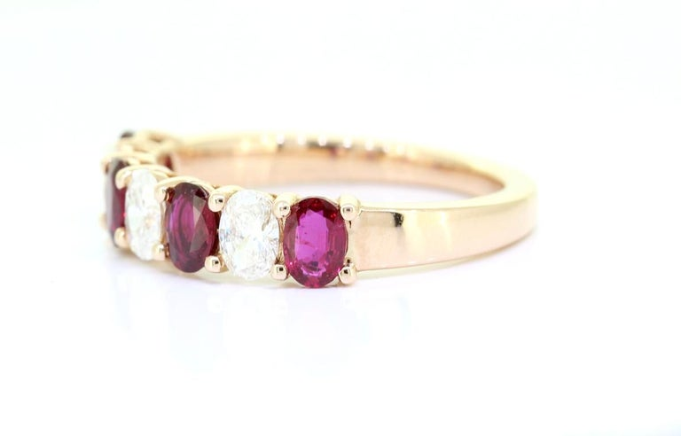 A Beautiful Handcrafted Ring in 18 Rose Karat Yellow Gold with Natural Brilliant Cut Oval Diamond and No Heat Mozambique Mined Rubies . A perfect Wedding Ring for the Special occasion.   Natural Diamond Details Pieces : 3 Pieces Weight : 0.55 Carat
