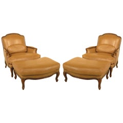 Classic Pair of Large French Louis XV Style Leather Bergères with Ottomans