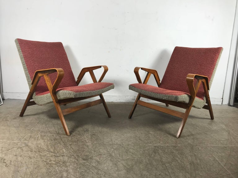 Classic pair of Mid-Century Modern bentwood lounge chairs in the manner of Carlo Mollino, retain original warm blonde wood patina as well as original two tone fabric upholstery, extremely comfortable, superior quality and construction, hand delivery