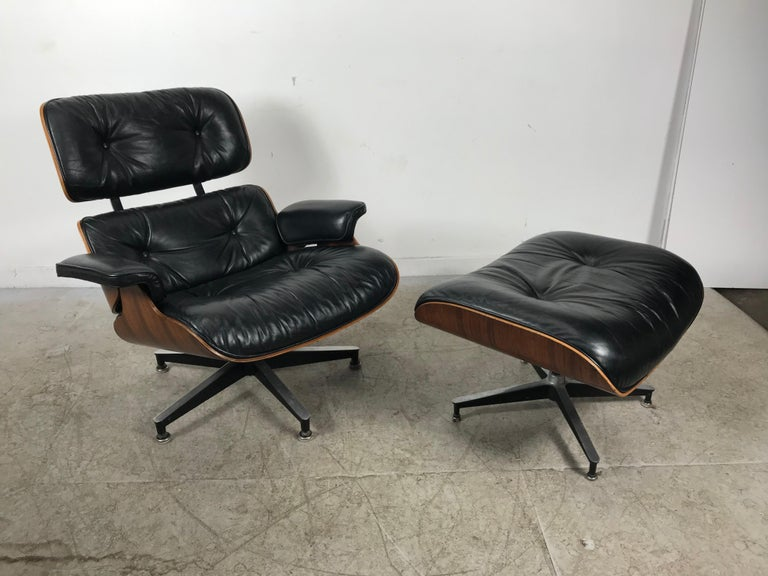 Classic rosewood and leather Eames lounge chair and ottoman, circa 1975 manufactured by Herman Miller. I've owned several, this is by far one of the best examples I have ever owned. Chair and ottoman both dated 1975. Have lived together since the