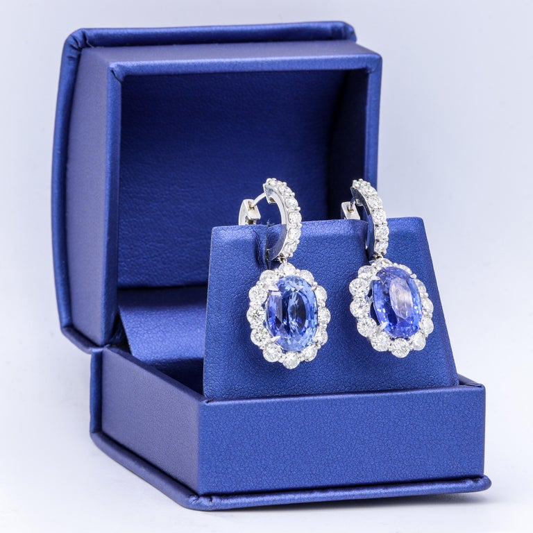 Classic sapphire diamond 18K white gold earring with GIA certified violetish blue sapphires 7.19 ct & 7.38 ct set with 4.80 ct  round diamonds all around.