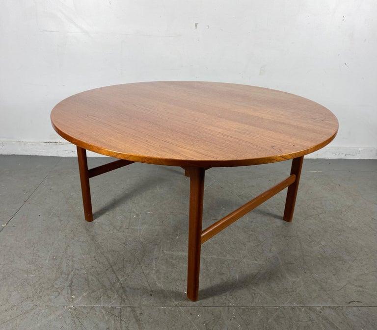 Seldom seen round version, Folke Ohlsson, Rapsodi teak coffee table, Tingströms, 1950s, retains original ink stamp to underside, nice original condition, patina.
