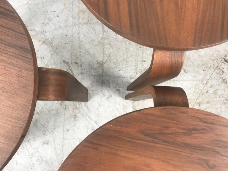 Classic set of 3 walnut stacking stools or tables manufactured by Thonet, in the style of Alvar Aalto, Three bentwood legs. Beautiful restored walnut finish, Versatile design,.
