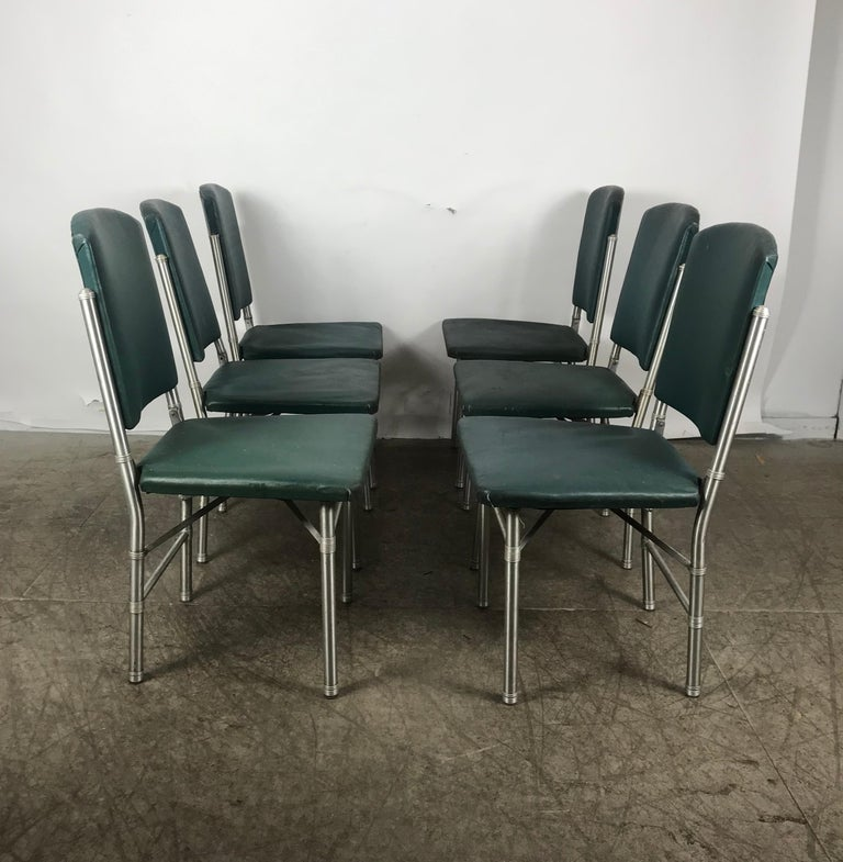 Classic set of 6 side Art Deco, Machine Age dining chairs designed by Warren McArthur.. Spun Aluminum and original oil cloth, fold for easy storage, retain original labels,.