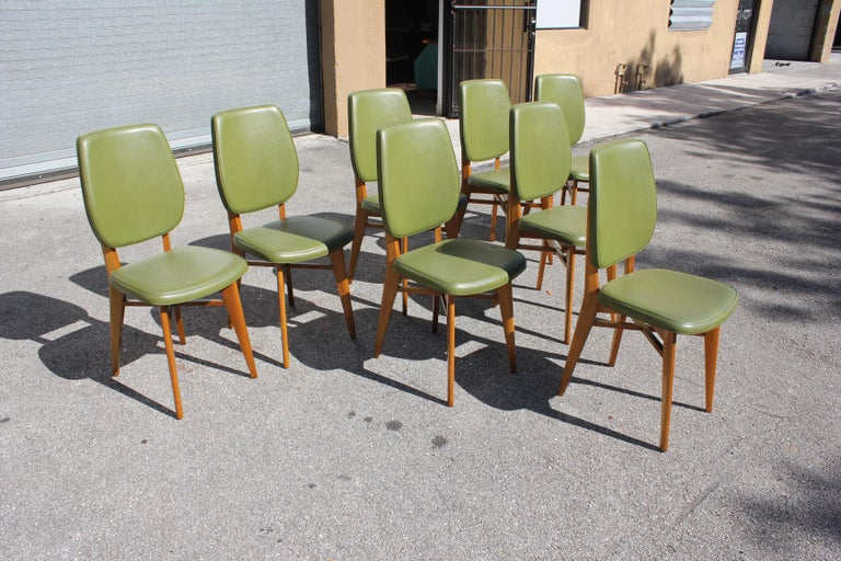 Classic set of 8 French Art Deco dining chairs solid mahogany, the chair frames are in excellent condition. (Reupholstery recommended to be change for 8 dining chairs), Green color vinyl original, we travelled to buy all our pieces in France. We