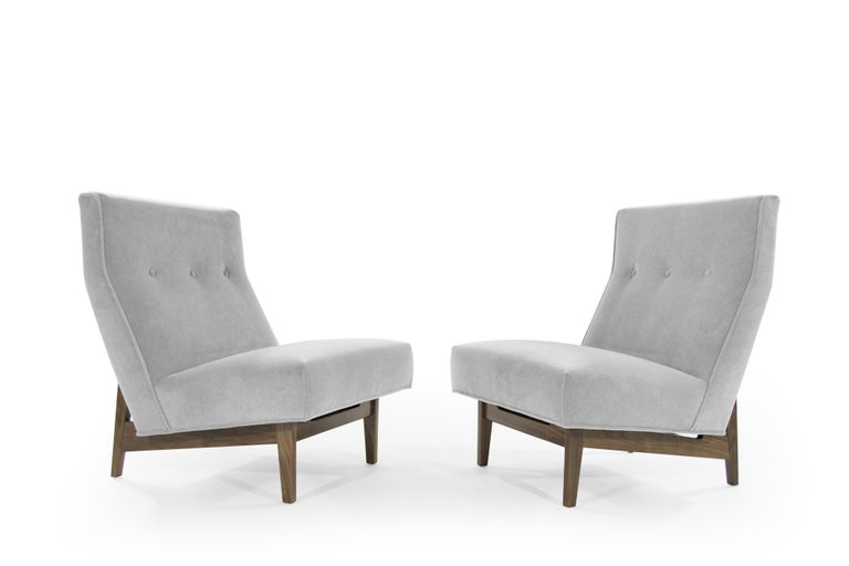 A set of slipper chairs designed by Jens Risom, circa 1950s.   This pair has been fully restored down to its bones, fitted with handcut high density foam. Newly upholstered in grey alpaca velvet by Holly Hunt. Walnut bases in perfect condition.
