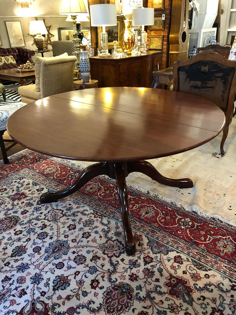Custom made English country style dining table in cherrywood. Made in England, this round table measures 60