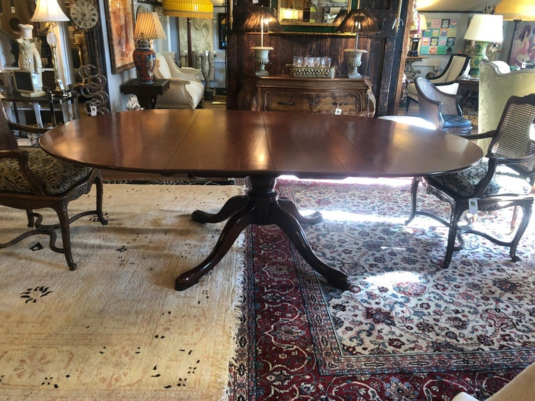 Classic Traditional Round Cherry Dining Table Extending to Large Oval For Sale 1