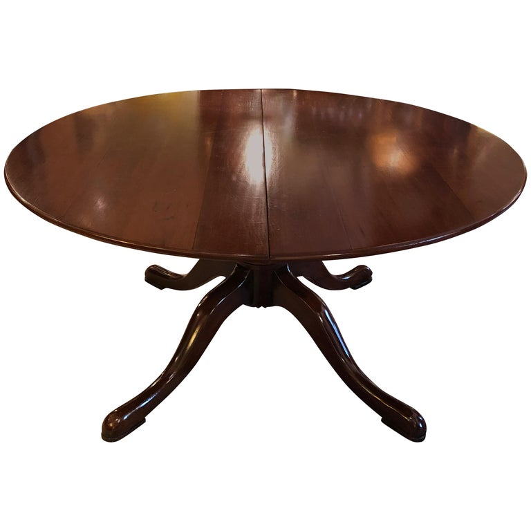 Classic Traditional Round Cherry Dining Table Extending to Large Oval For Sale