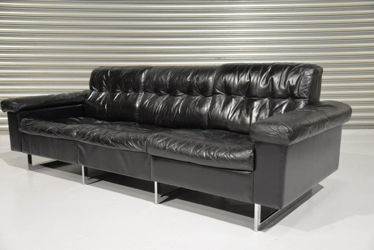 Discounted airfreight for our US and International customers ( from 2 weeks door to door )  A vintage de Sede three-seat sofa in stunning black leather. Hand built in he 1970s by de Sede craftsman in Switzerland, this original sofa stands on