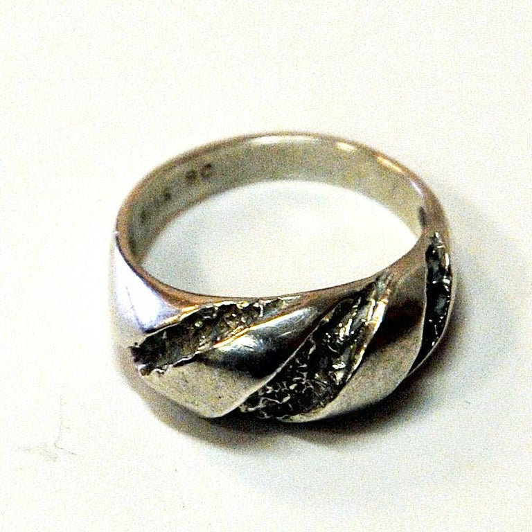 Decorative vintage Scandinavian silvering with a rough cut surface and nice design by Guldateljen AB, Sweden, 1980s.  Stamped: 935S BC. Measures: Inner diameter is 17mm, total height of ring 22 mm. Scandinavian design. Nice and natural patina and