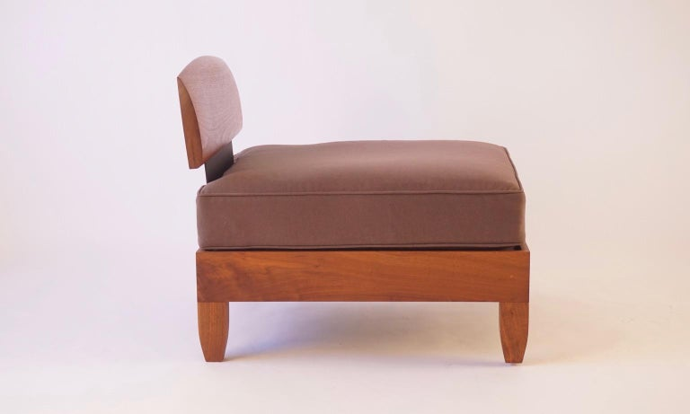 This club chair was designed soon after the classic daybed and has the same Scandinavian and African influences and construction techniques. This version is made from black walnut with blackened aluminium side supports and with a rubbed oil finish.