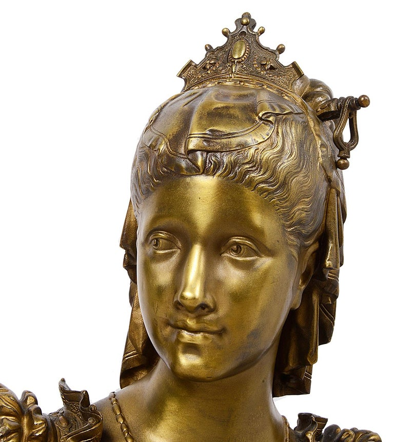 A very good quality late 19th century French patinated bronze bust of a Maiden, raised on a stepped bases.