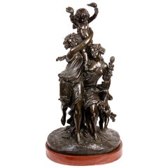 Classical 19th Century Bronze Group of Two Maidens Carry a Cherub