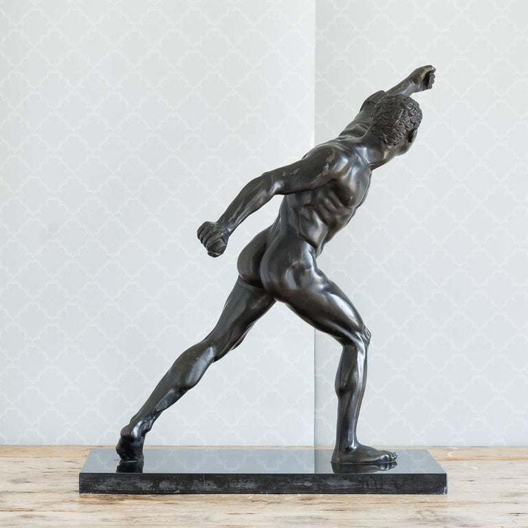 Classical bronze model of the Borghese Gladiator, late 19th century, possibly German, set on a Belgian black marble base.