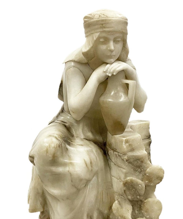 An enchanting 19th century carved Alabaster statue of a young seated Arab girl holding a water carrier.