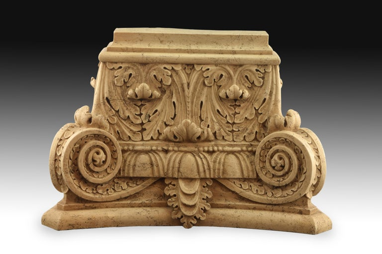 Classical style capital. Modeled alabaster (resins and silica gel composition). 20th century. Architectural capital composed of a series of smooth moldings above and below, and rows of acanthus leaves carved under scrolls decorated with plant