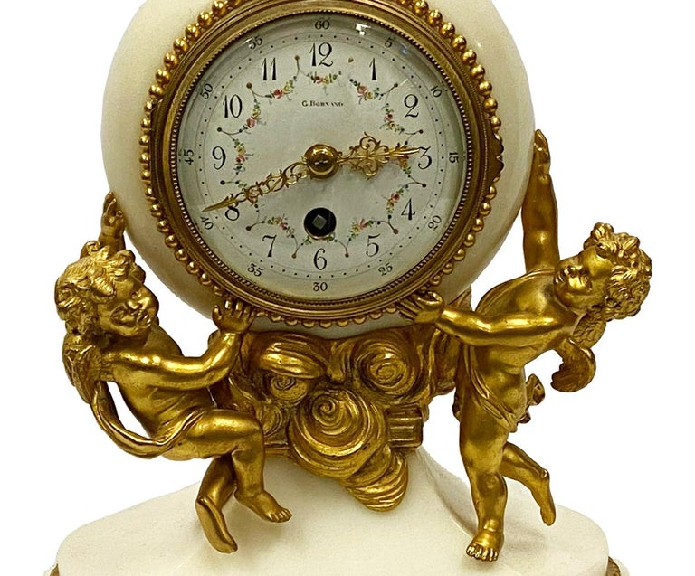 Gilt Classical French 19th Century Louis XVI Style Clock Set For Sale