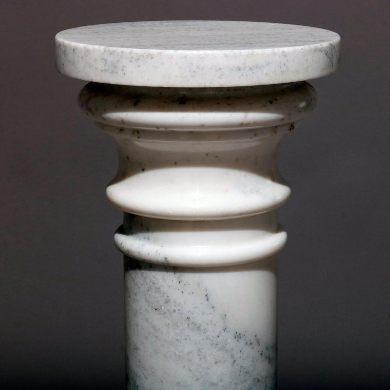 A classical Italian marble sculpture display pedestal features Doric column form with stepped base and display, 20th century