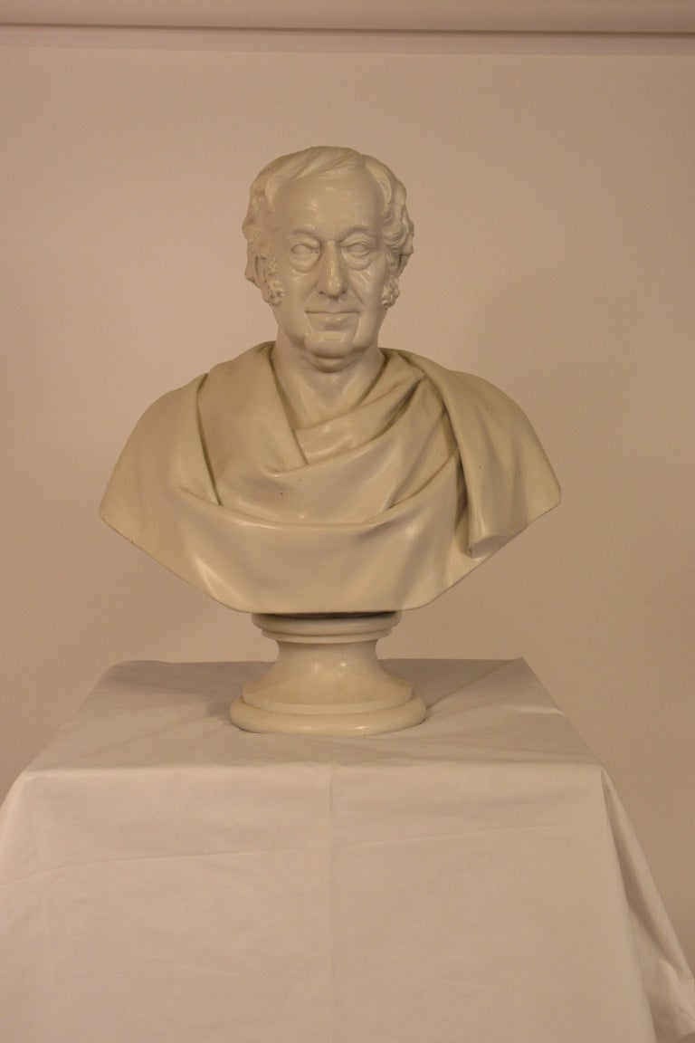 Classical plaster bust of man.