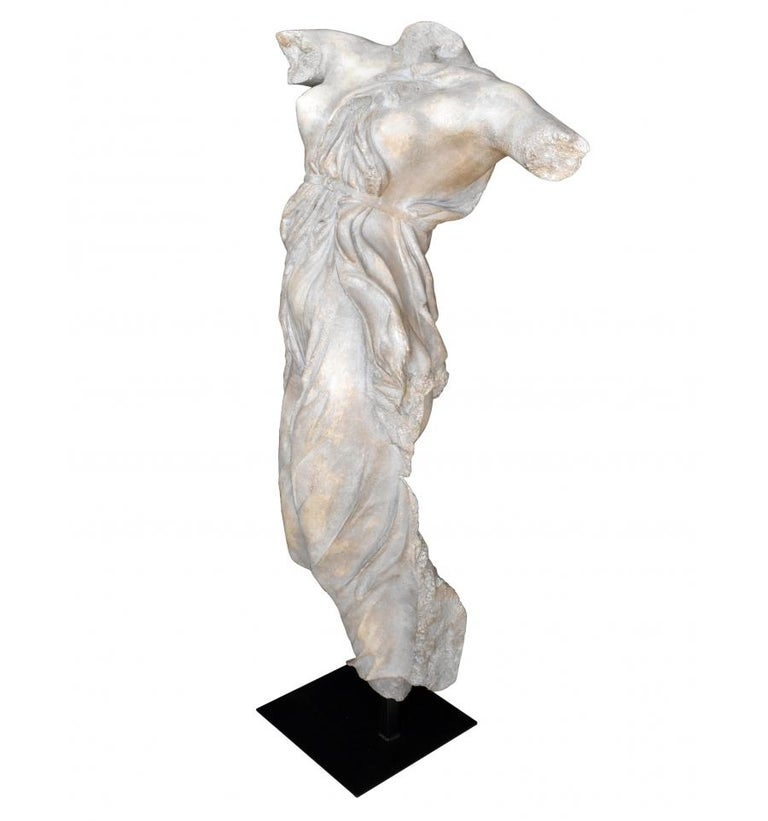 Classical Roman female dancing torso sculpture in resin imitating marble on an iron pedestal. Top quality antique imitation of the erosion and passing of time.