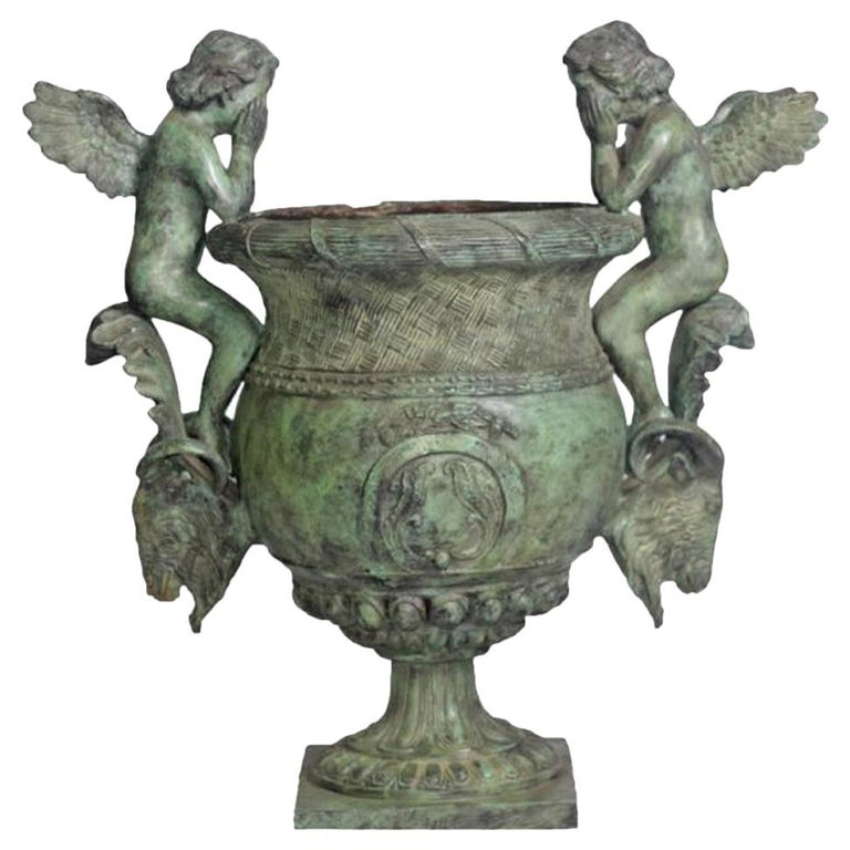 Classical Style Cast Bronze Urn with Two Cupids and Rams' Heads, Verde Patina For Sale