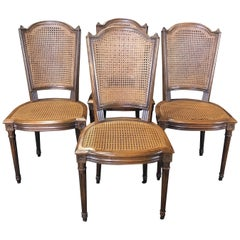 Classically Beautiful Set of 4 French Louis XVI Walnut and Caned Dining Chairs