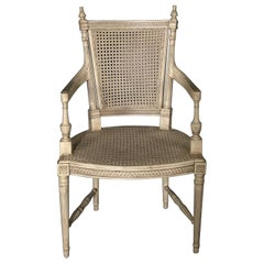 Classically Elegant French Louis XVI Style Painted Armchair with Double Caning