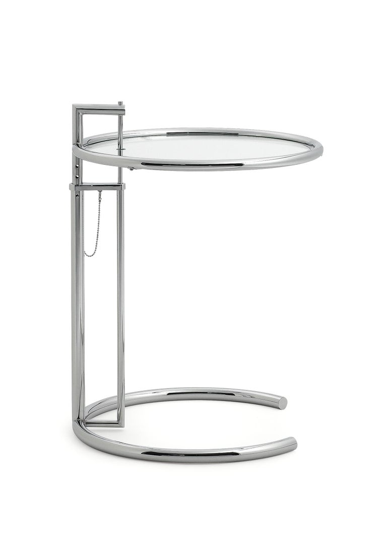 """This is perhaps the Classic among the classics. Its ingeniously proportioned, distinctive form has made this height-adjustable table one of the most popular design icons of the 20th century. It is named after the summer house E 1027 """"Maison en bord"""