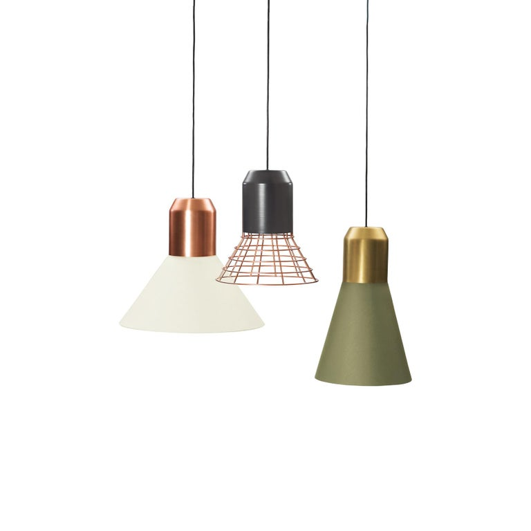 Sebastian Herkner's bell lights reveal their adaptability and flexibility at the very first glance. Each of the lampshades in this family of pendant lamps can be combined with a choice of sleek cylindrical bulb sockets in grey, brass or copper and