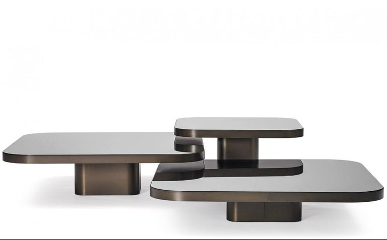 Inspired by 1970s lines and designs, Brazilian Guilherme Torres presents a side table or coffee table of casual elegance. The metal-covered surface of the body also quotes futuristic designs of the era, but it is a clearly contemporary design. The
