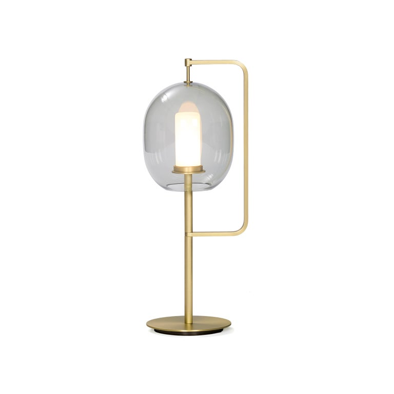 In our everyday existence, light serves us by enhancing everything around it, while it is often neglected itself. Here, the inspiration comes from the quintessential source of light; like its ancient predecessor, the fiery torch, this design simply