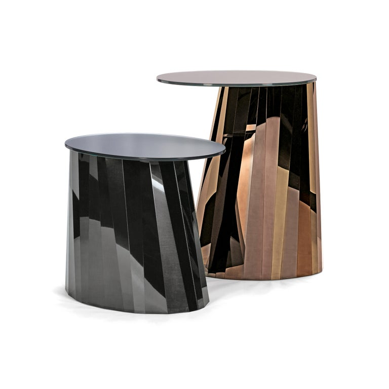 With the Pli side table series French designer Victoria Wilmotte brings objects of unusual crystalline elegance and astonishing geometry to living environments. The bends and folds that gave Pli its name almost make the stainless steel base look