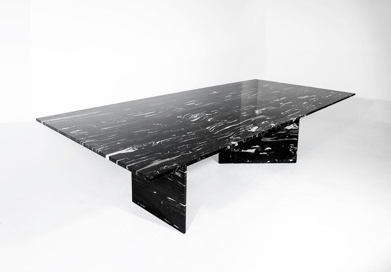 This table combines the beauty of marble with a twist of suspense. The triangular legs create for several differing view points where the table in turn feels as if it is supported by the thinnest blades of marble prompting a sense of disbelief yet