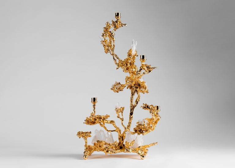 Claude Boeltz's five branch candelabrum possesses the asymmetry of trickling water frozen in intense cold, a form further suggested by the quartz crystals set throughout. Yet, as with much of Boeltz's work, the piece is remarkable for the artist's