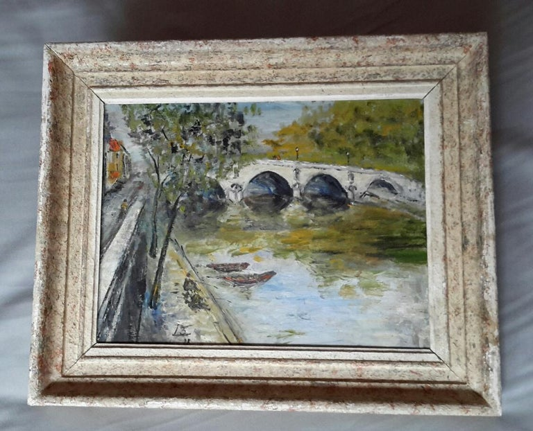 """Charming 1940's Claude Bouteur landscape Oil on a wood panel painting in a Post Impressionist style representing the banks of Seine River and the Pont Marie Bridge, a lovely composition Parisian in the 1940""""s signed by a monnograme  and dated on the"""