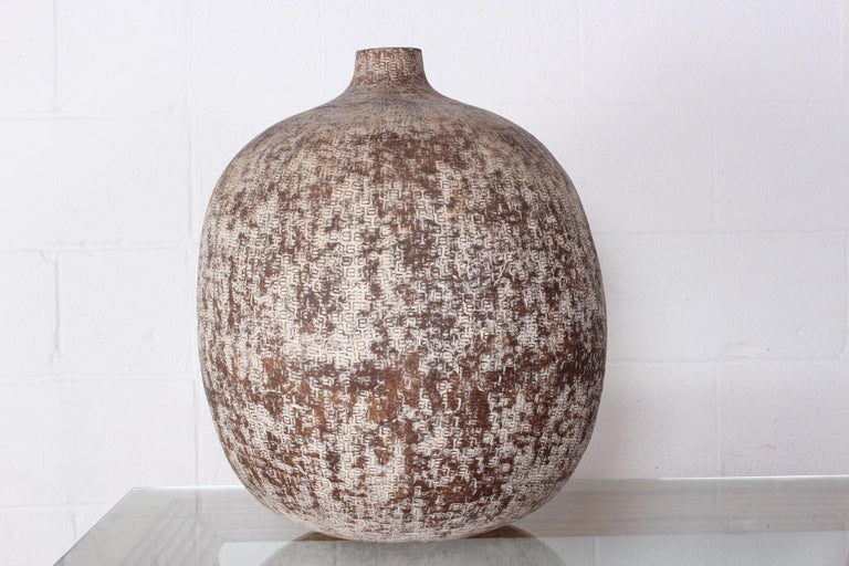 A large ceramic vase titled