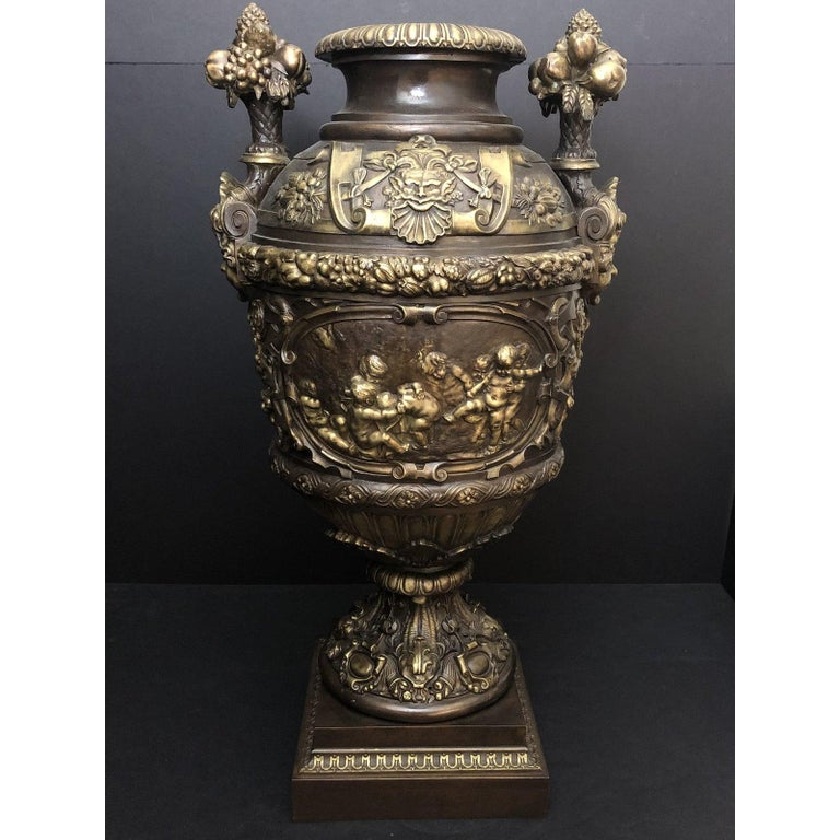 Claude Michel Clodion Doré Patinated and Gilt Bronze Vase. Grand scale 19th century Doré and patinated bronze centerpiece urn