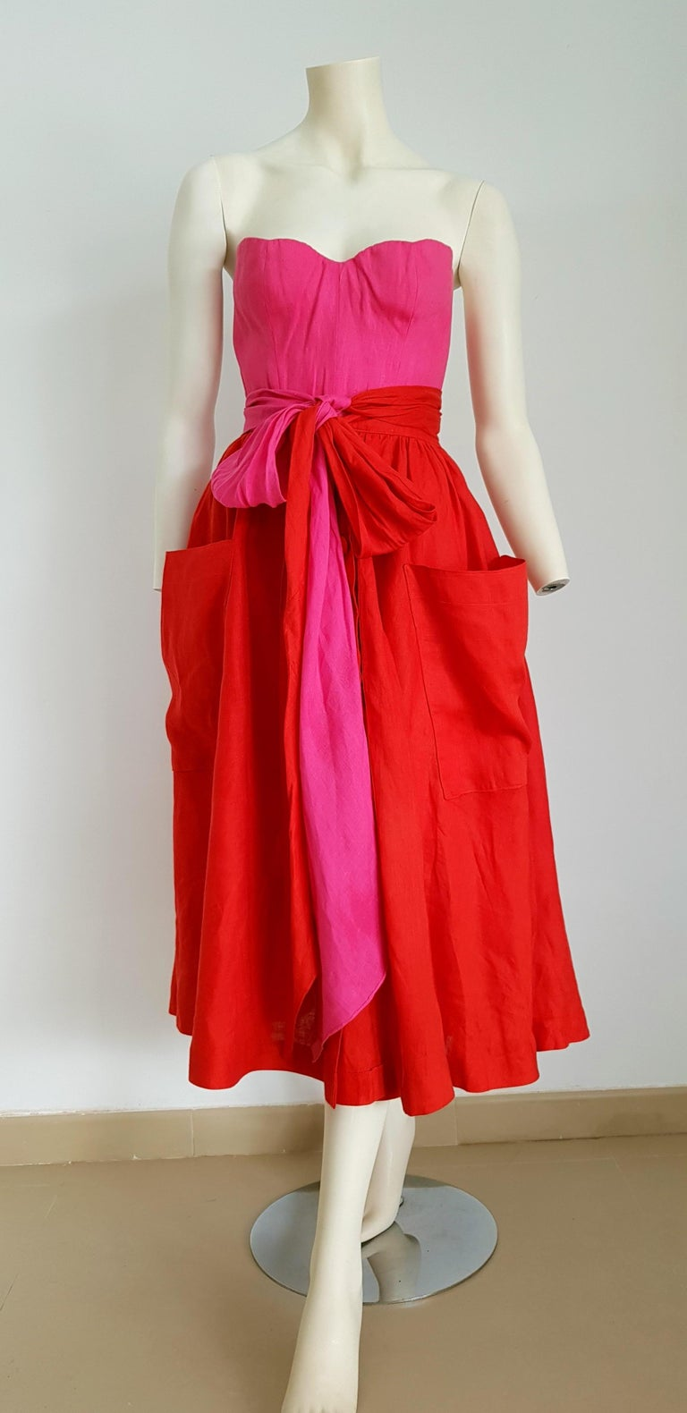 Claude MONTANA Haute Couture, corset knotted bands at the waist, red and fuchsia dress - Unworn  SIZE: equivalent to about Small / Medium, please review approx measurements as follows in cm.  TOP: lenght 35, chest underarm to underarm 50, bust