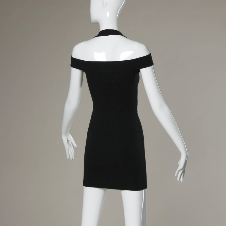 Sexy black stretchy body con dress by Claude Montana. Unique body hugging fit with cut out shoulders and halter neckline. No marked size, but fits like an XS-S.