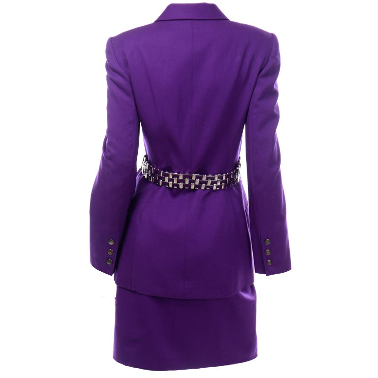 This is a fabulous Claude Montana vintage 1990's purple wool skirt suit with silver hardware & leather back belt attached to the jacket. You can wear this outfit as a suit or break up the set for 2 great separates! This incredible suit has a