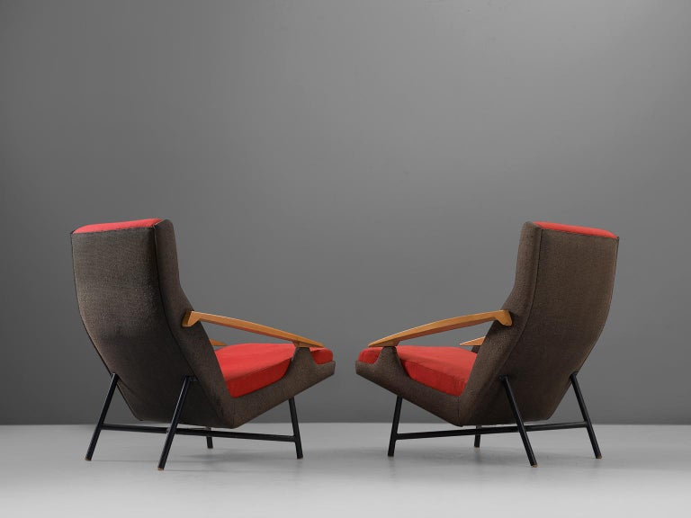 Set of two lounge chairs, in beech, metal and fabric, by Claude Vassal, France, 1950s.   A pair of modern armchairs in black and red upholstery. These chairs show an interesting combination of materials and get therefore their unique appearance.
