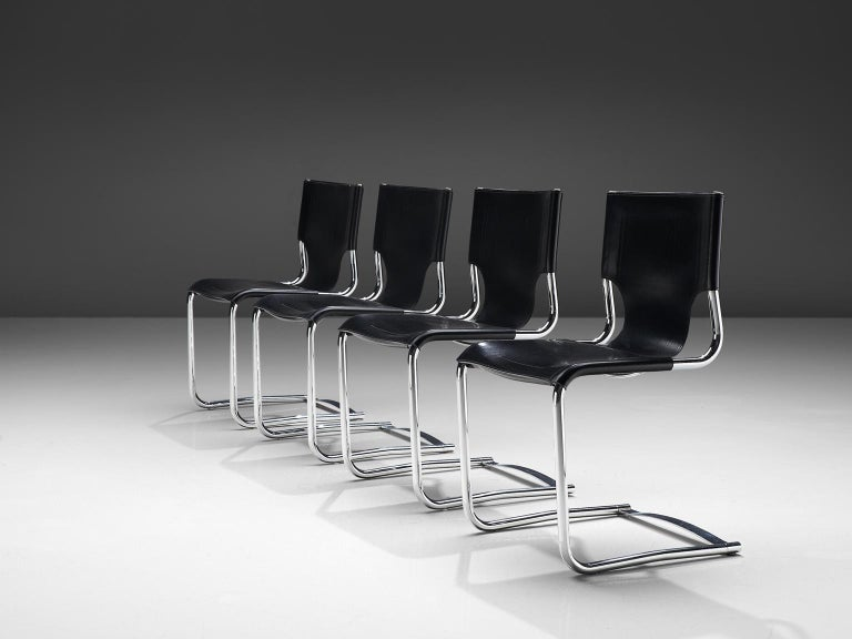 Carlo Bartoli, set of four dining chairs '920', black leather and steel, Italy, 1971.  This elegant set of cantilevered tubular frame chairs are executed with the finest black leather that is used as a shell for both seat and back. The sides of