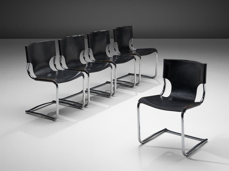 Carlo Bartoli, set of five dining chairs '920', black leather and steel, Italy, 1971.  This elegant set of cantilevered tubular frame chairs are executed with the finest black leather that is used as a shell for both seat and back. The sides of