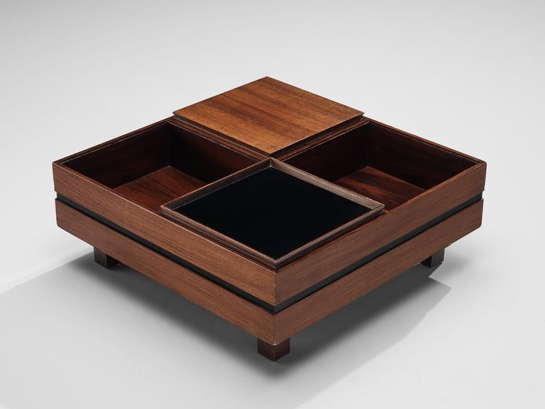 Claudio Salocchi, coffee table, rosewood, walnut, Italy, 1960s.  Italian designer Claudio Salocchi provides a clearly structured coffee table with a strong visual effect and a combination of walnut and rosewood. On low height the quadratic side