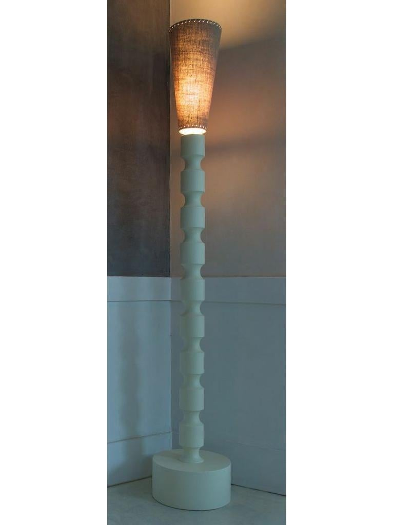 This original, minimal totemic 21st century artisanal floor lamp, reminiscent of 20th century Scandinavian design and Brancusi's Totem sculptures, is also a modern take on 18th century architectural details. Claus Floor Lamp is designed by Wende